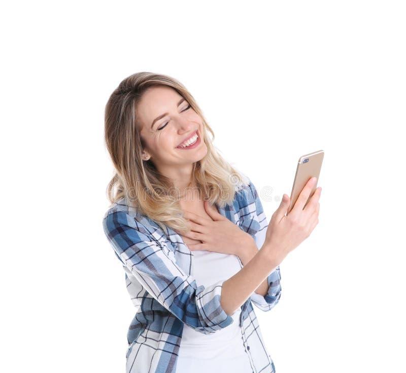 使用手机的妇女为在白色的视频聊天 库存照片