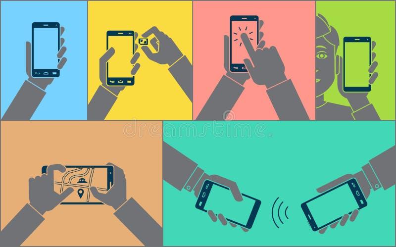 使用手机的手 免版税库存照片