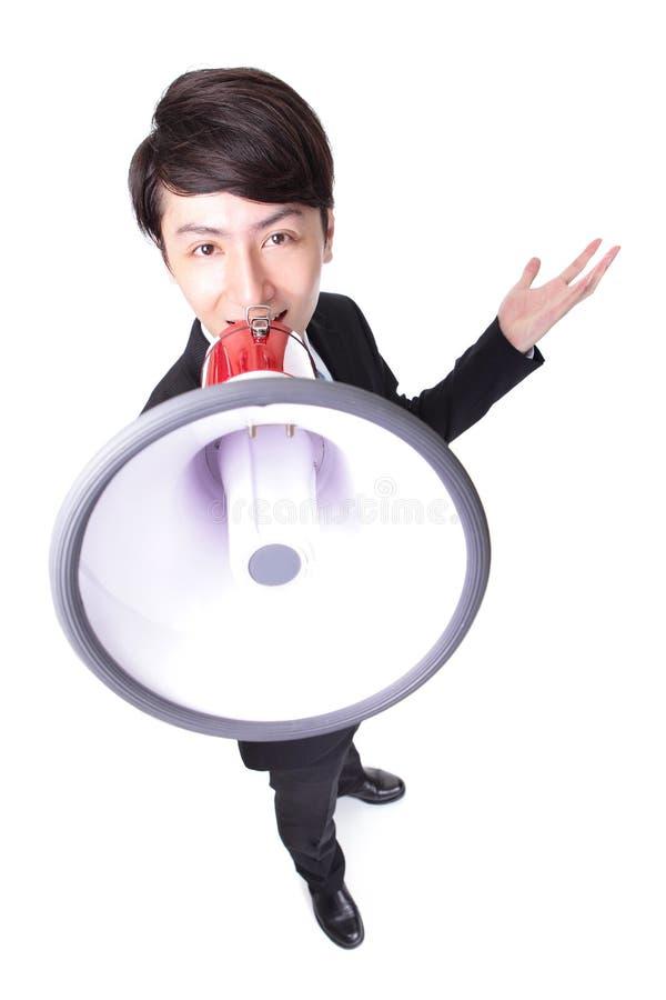 使用扩音机的愉快的亚洲商人 库存图片