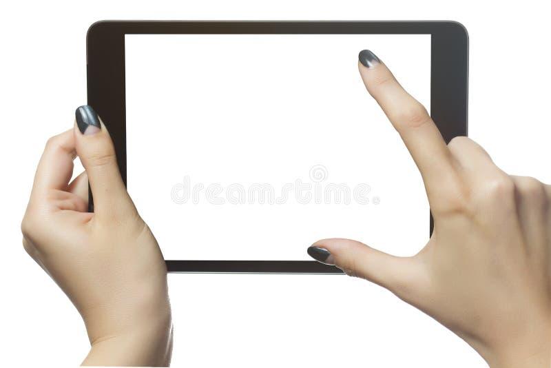 使用数字式片剂的妇女手 使用大模型的 电子教学c 免版税库存照片