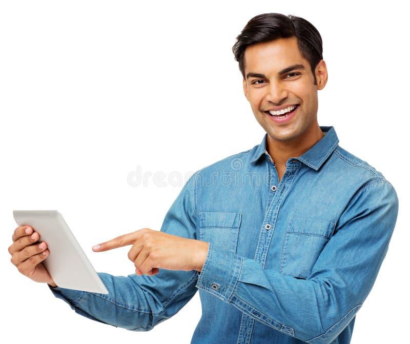 使用数字式片剂的微笑的人 库存图片