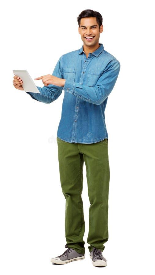 使用数字式片剂的确信的年轻人 免版税库存图片