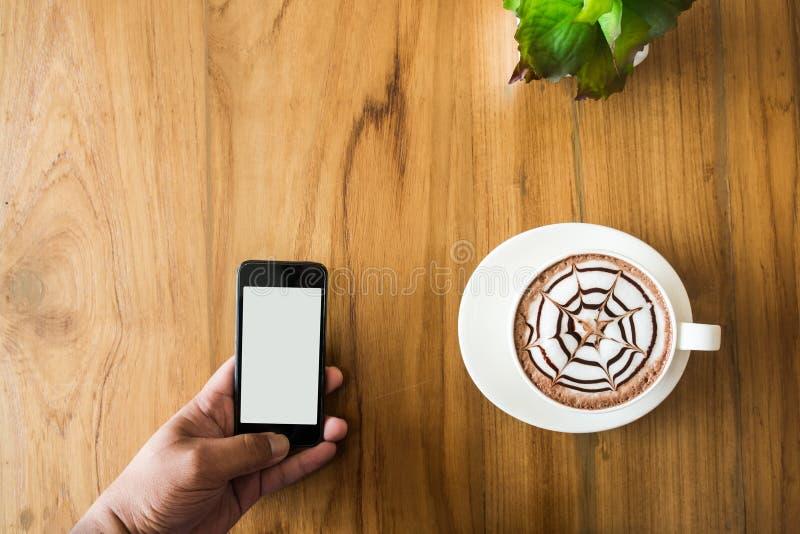 使用智能手机的手 免版税图库摄影