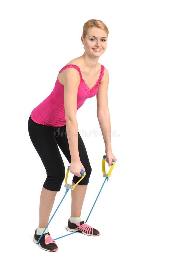 使用橡胶抵抗带的后面引伸锻炼 图库摄影