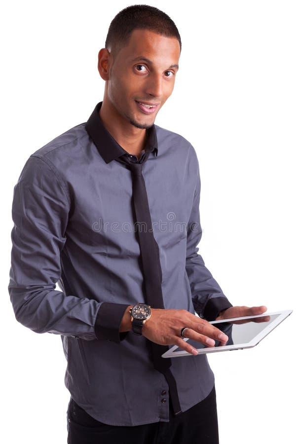 使用片剂个人计算机的新非洲裔美国人的人 图库摄影