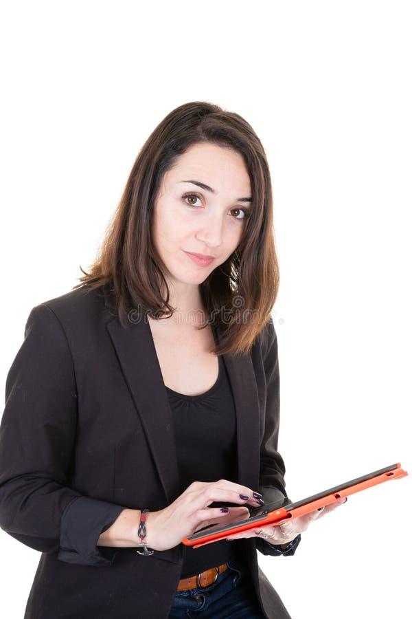 使用片剂计算机的快乐的有吸引力的年轻女实业家身分在白色背景 库存照片