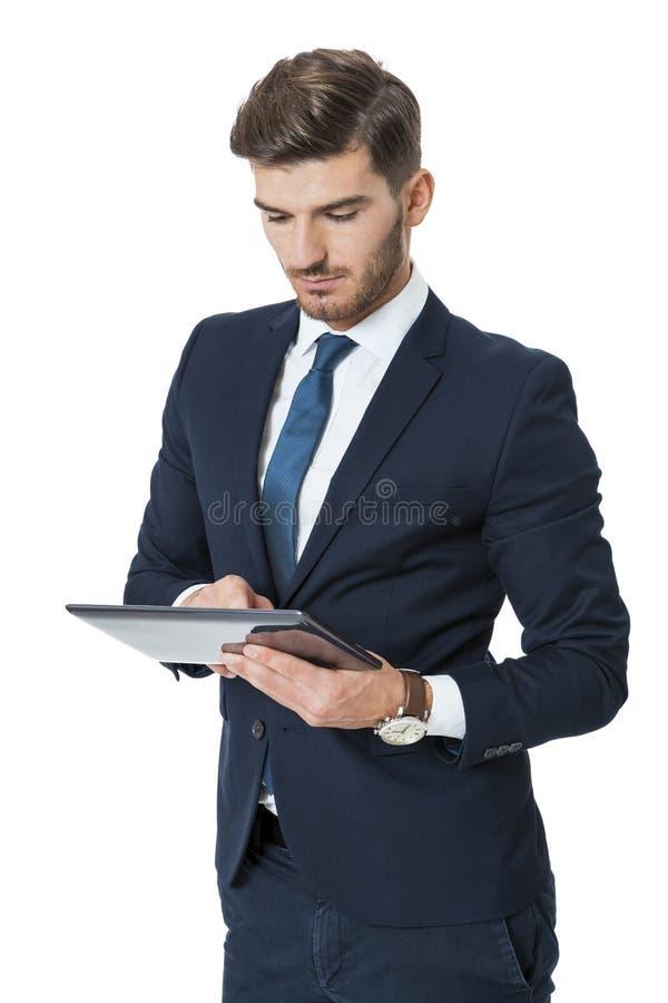 使用片剂计算机的生意人 免版税库存照片