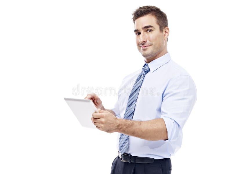 使用片剂计算机的白种人商人 库存照片