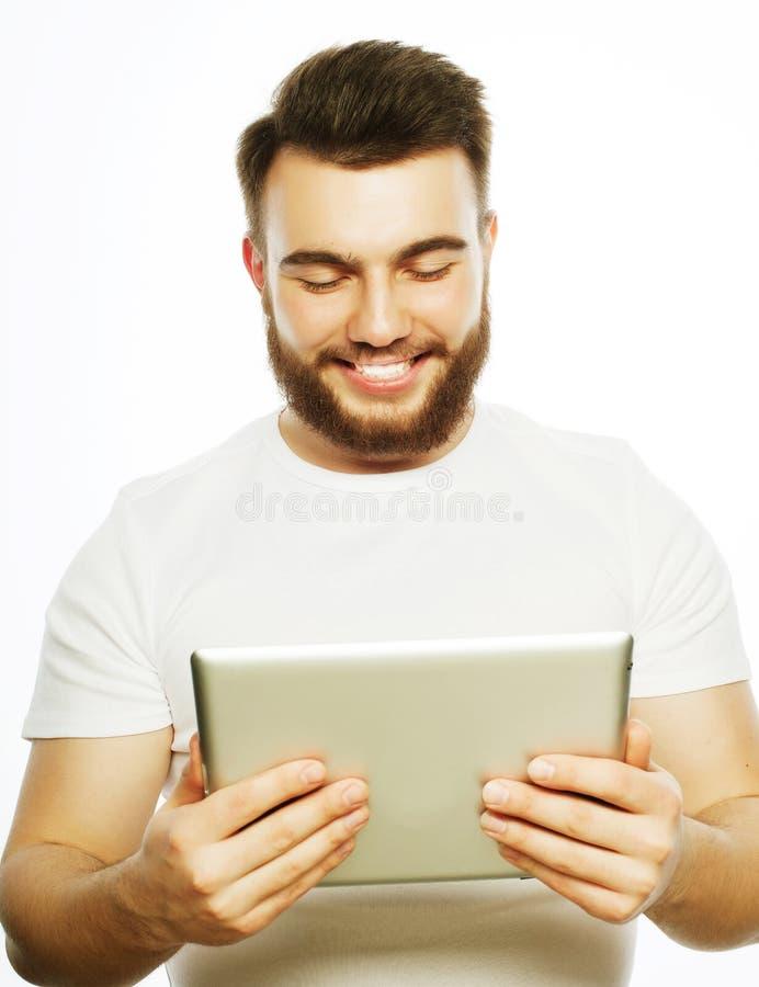 使用片剂计算机的年轻人 免版税库存图片