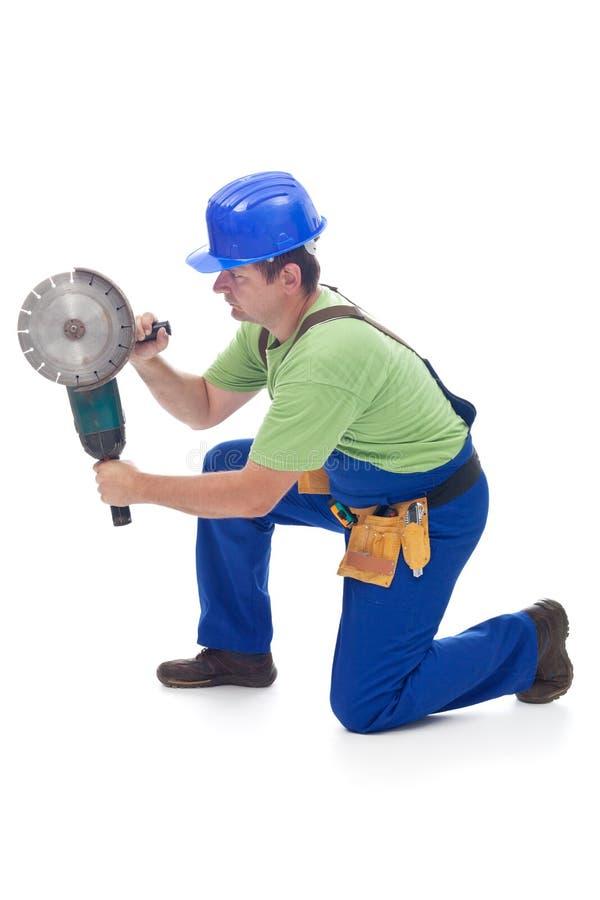 使用电动工具的工作者 库存图片