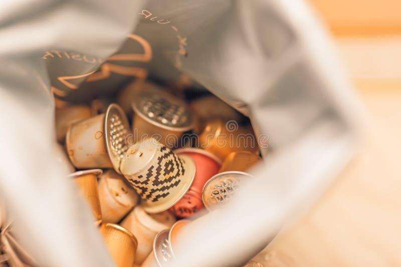 使用的咖啡胶囊回收袋子 免版税图库摄影