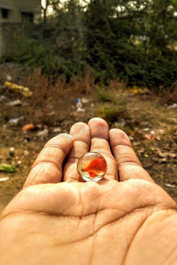 使用的大理石球在手上 免版税库存图片