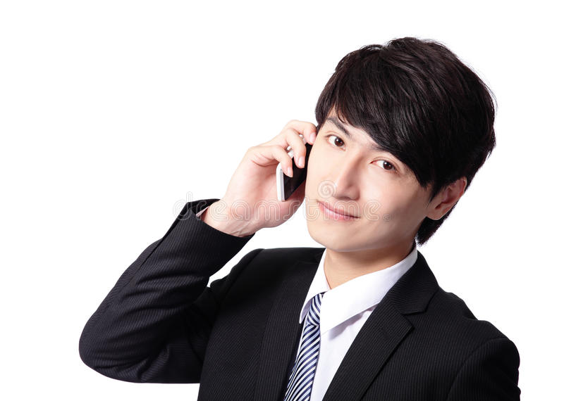 使用移动电话的亚洲生意人 免版税库存照片