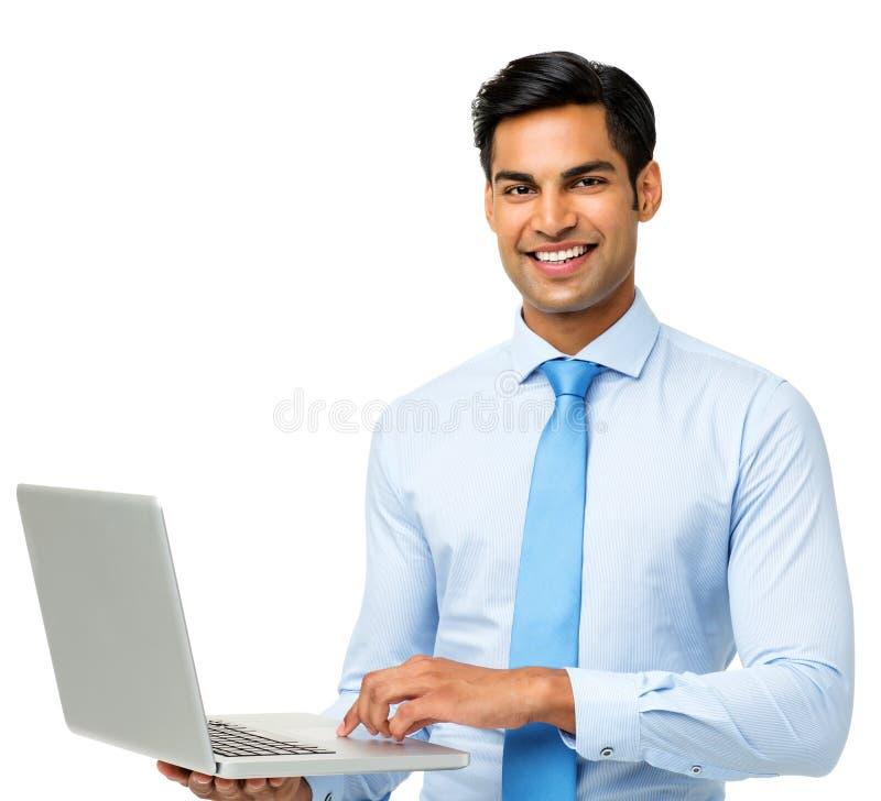 使用膝上型计算机的确信的商人 免版税库存照片