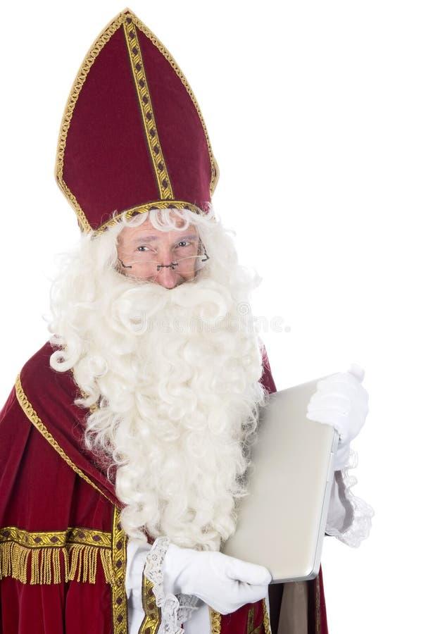 使用膝上型计算机的Sinterklaas 图库摄影