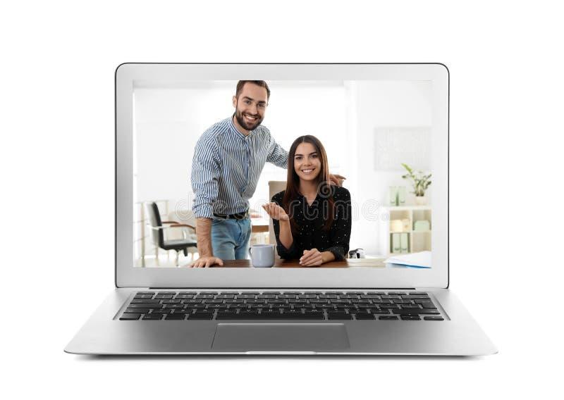 使用视频聊天的膝上型计算机与白色的人 库存图片