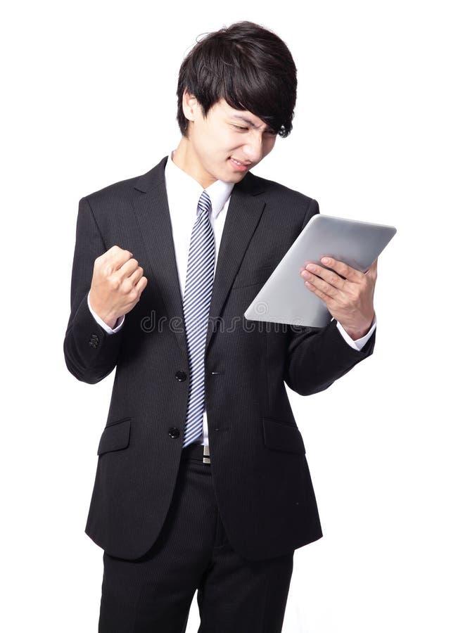使用触摸板的亚洲生意人有懊恼表面的 免版税库存图片