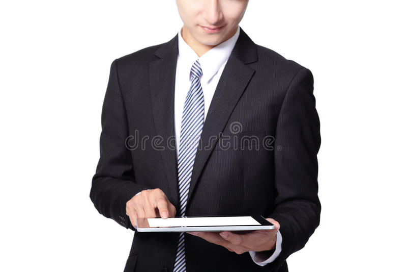 使用触摸板的生意人 免版税库存照片