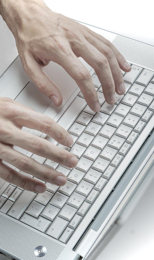 使用键盘的男性手 图库摄影