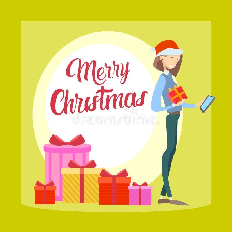 使用细胞巧妙的电话圣诞快乐新年,愉快的女商人举行礼物箱子 皇族释放例证