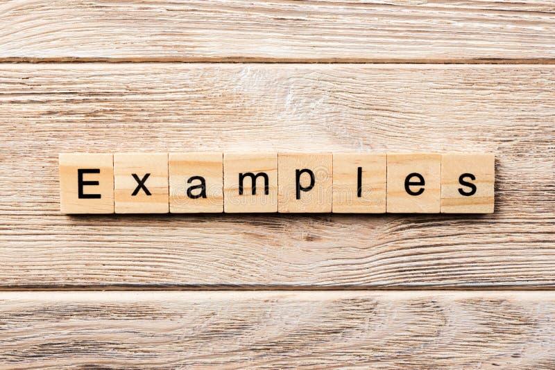 例子在木刻措辞写 在桌上的例子文本,概念 免版税库存图片