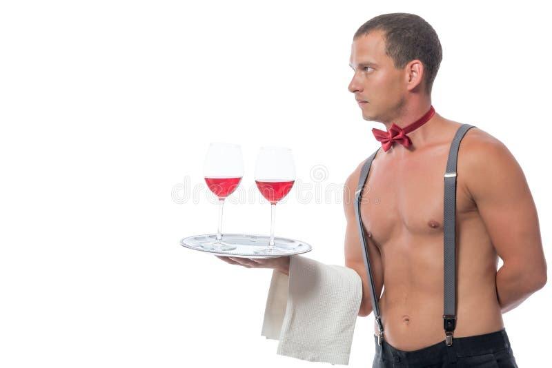 侍者的水平的画象戴酒的眼镜的 库存图片