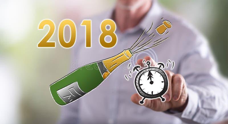 供以人员在触摸屏上的感人的新年2018年 库存图片