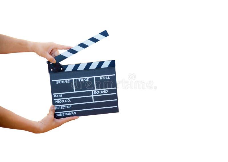 供以人员拿着电影拍板的手被隔绝在白色背景 库存图片