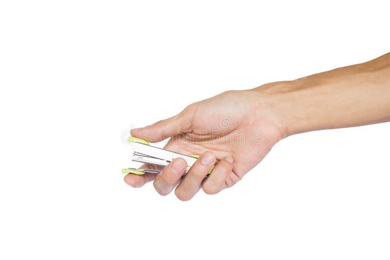 供以人员拿着绿色金属订书机的手准备好对在与裁减路线的白色背景隔绝的钉 免版税库存照片