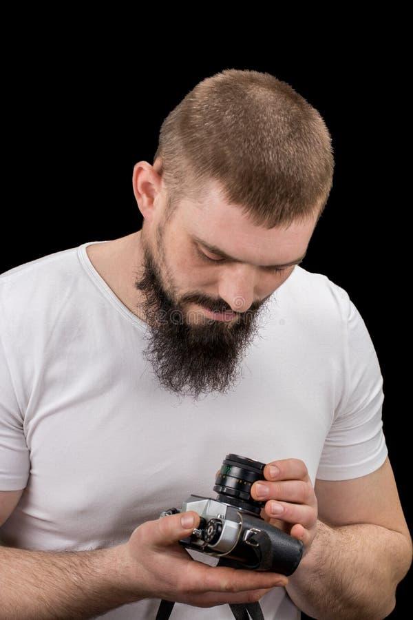 供以人员行家,拿着葡萄酒照相机在手上 免版税库存图片