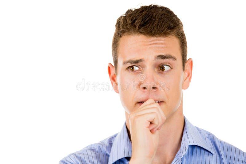 供以人员咬住他的拇指指甲盖或手指在嘴 免版税库存照片