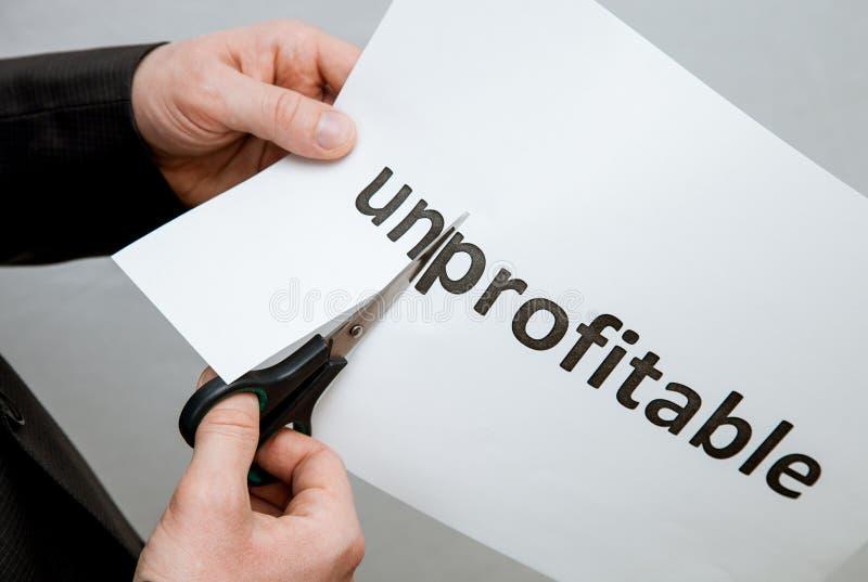 供以人员在一张纸的切口题字与剪刀 免版税库存照片