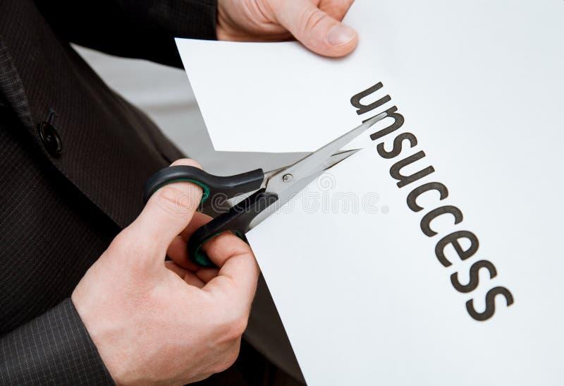 供以人员在一张纸的切口题字与剪刀 免版税图库摄影