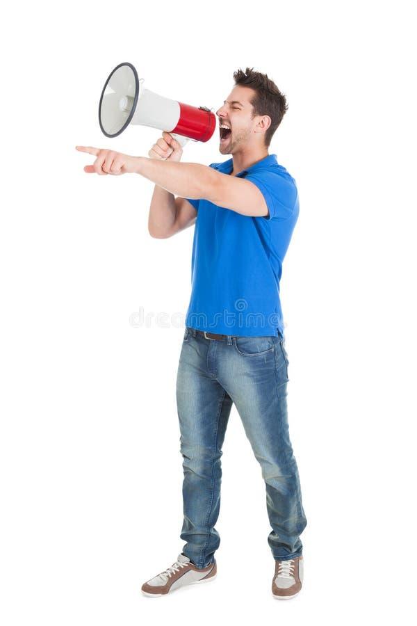 供以人员尖叫入手提式扬声机,当指向时 免版税库存照片