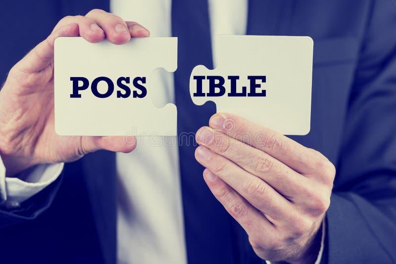 供以人员拿着与词的难题片断可能 免版税库存照片