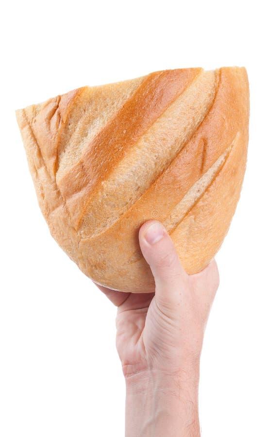 供以人员拿着新鲜面包在手上,隔绝在白色背景 免版税库存图片