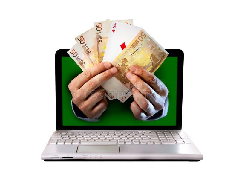 供以人员拿着欧洲钞票和一点啤牌纸牌的手以后的outlaptop 库存图片