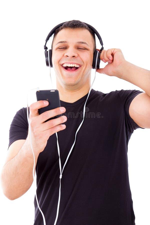 供以人员笑的观看和在手机的听的广播节目 免版税库存图片