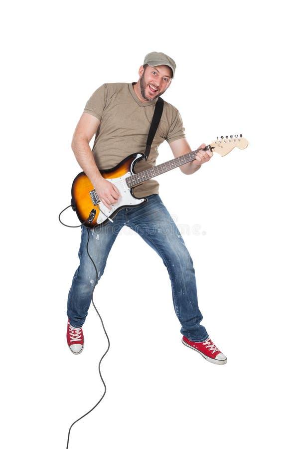 供以人员跳跃与电吉他在天空中,隔绝在白色 免版税图库摄影