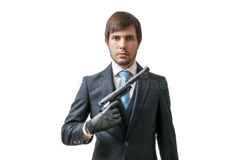 侦探或凶手有手枪的在手中 查出在白色 库存图片