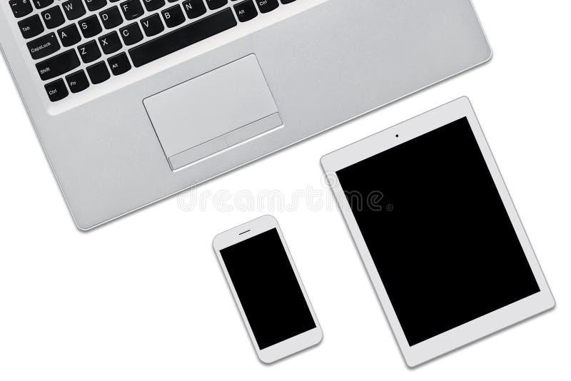 便携式计算机、片剂和在与拷贝空间的白色背景隔绝的手机您的adverisment或增进文本的 Thre 免版税库存照片