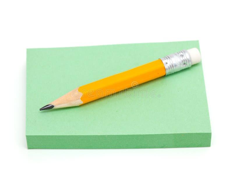 便条纸和灰色铅笔 免版税图库摄影