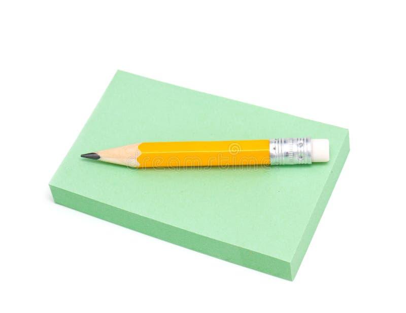 便条纸和灰色铅笔 库存照片