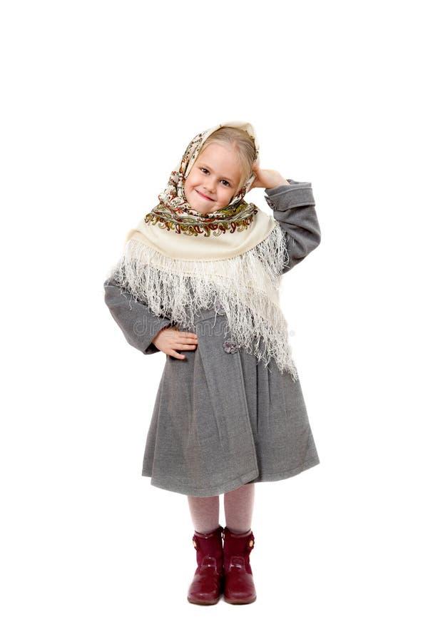 俄国方巾的微笑的小女孩 免版税图库摄影