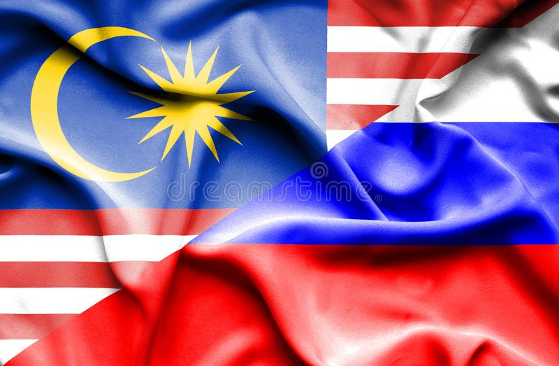 俄罗斯和马来西亚的挥动的旗子 库存例证