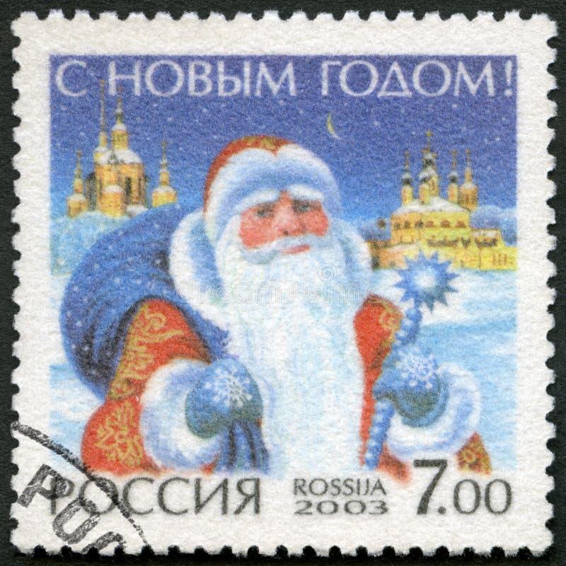 俄罗斯- 2003年:展示圣诞老人,虔诚新年快乐 免版税图库摄影