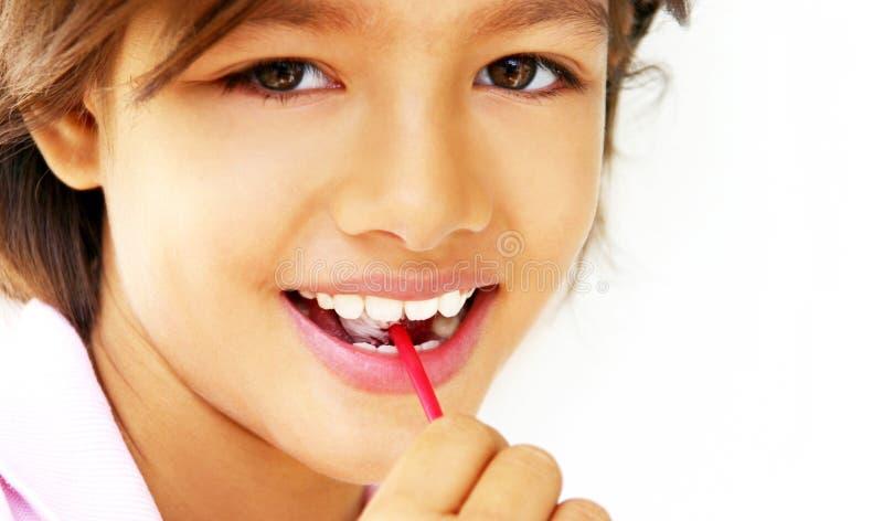 俏丽女孩的棒棒糖 免版税库存照片
