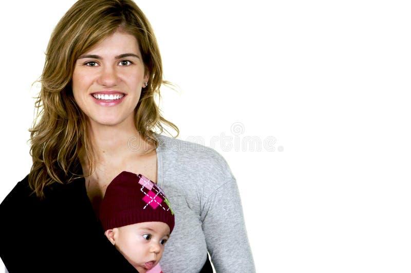 俏丽婴孩现代的妈妈 免版税库存照片