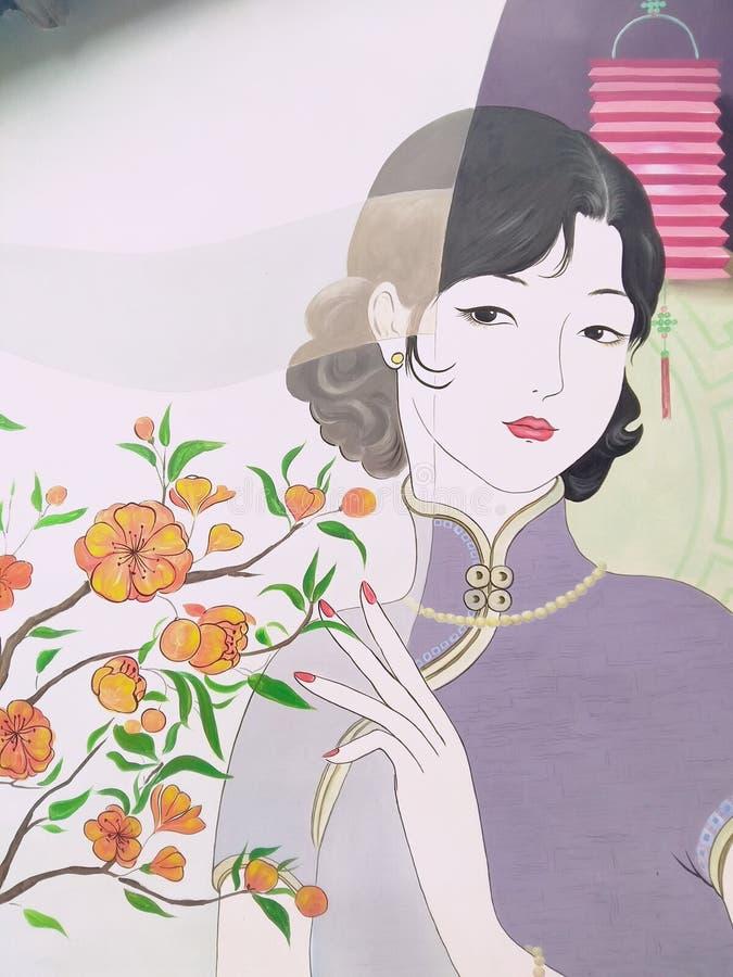 俏丽的夫人在Qipao中国 库存图片