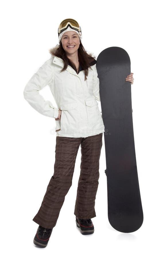 俏丽的女子挡雪板 库存图片